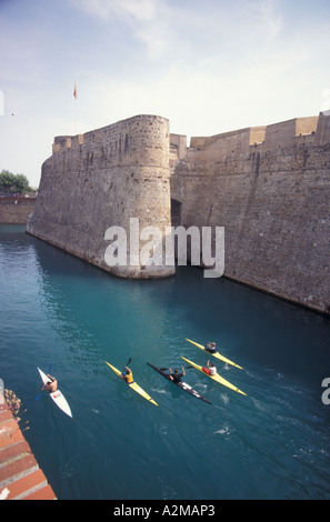 Europe, Spain (in Spanish northern Africa), Ceuta, royal walls and waterway with kayakers - Stock Photo