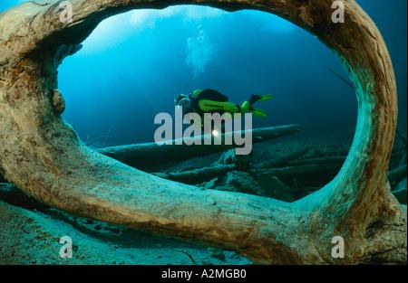 scuba diver in clear mountain lake, Samaranger See, Austria - Stock Photo
