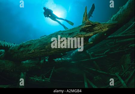scuba diver in clear mountain lake - Stock Photo