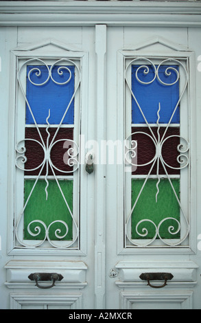 two typically ornate southern european timber doors - Stock Photo
