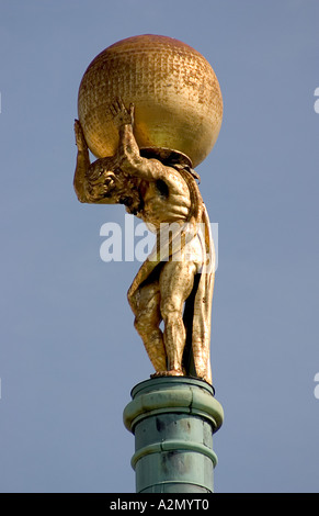 Atlas on the old guildhall; cityhall - Stock Photo