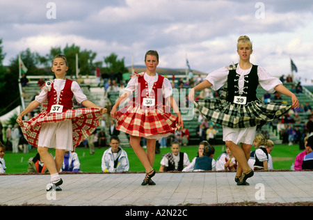 Traditional Scottish Highland dancing contest at the Braemar Gathering highland games in Grampian region of Scotland - Stock Photo