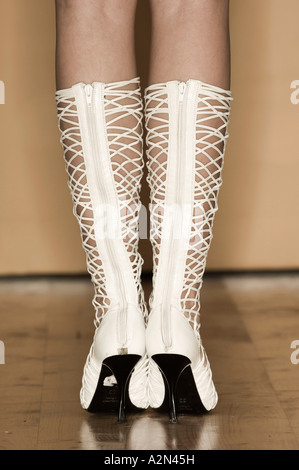 Rear view close-up on white corded ladies' boots - Stock Photo