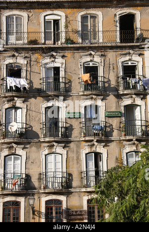 A rundown and crowded apartment block in downtown Lisbon, Portugal - Stock Photo