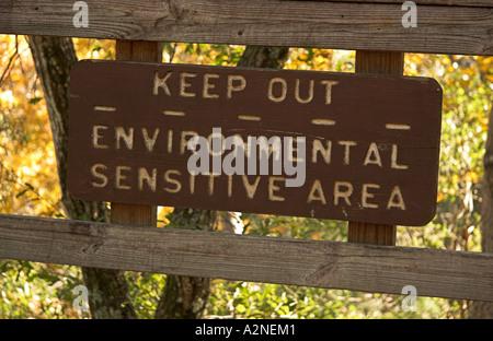 A sign warning about environmental sensitive area at lake Eaton sinkhole, Ocala National Forest, Florida, USA - Stock Photo