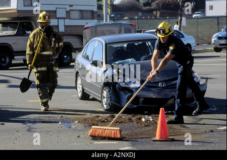 Cleaning up after apparent red running incident at Lincoln Boulevard and Manchester Ave in Westchester, Los Angeles - Stock Photo