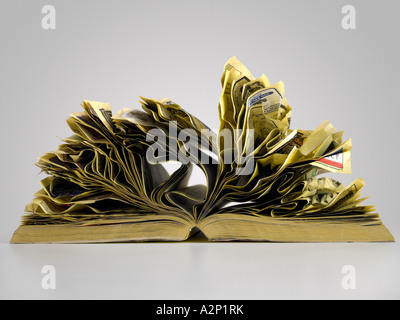 Crumpled pages of telephone directory - Stock Photo