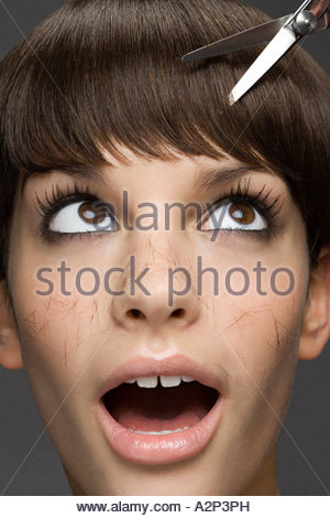 Young woman having a haircut - Stock Photo