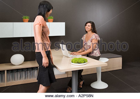Two female office workers - Stock Photo