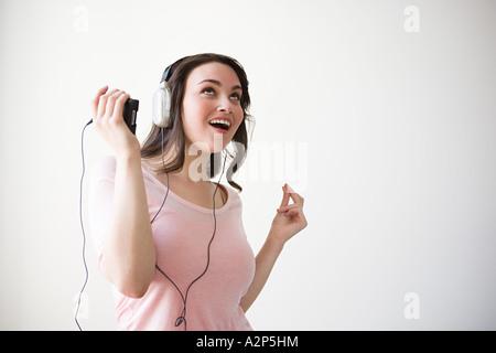 Young woman enjoying music - Stock Photo