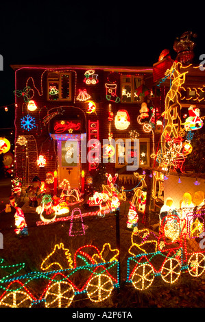 illuminated house lights christmas lights and decorations on a house at the corner of roman
