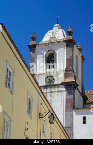 The bell tower and clock of Silves Cathedral in the Algarve region of southern Portugal Europe - Stock Photo