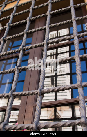 Siena cathedral tower reflected in the window, Italy - Stock Photo