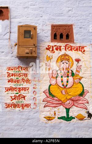 India Rajasthan Jaisalmer religion painting of Hindu god Ganesh on house wall - Stock Photo