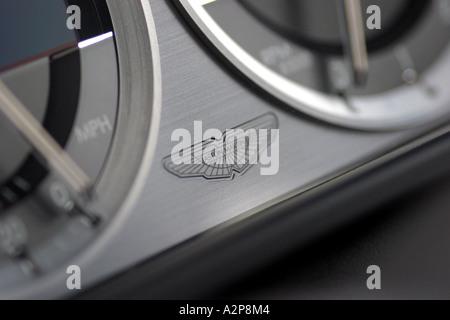 interior view of dashboard logo of an Aston Martin DB9 sports car - Stock Photo