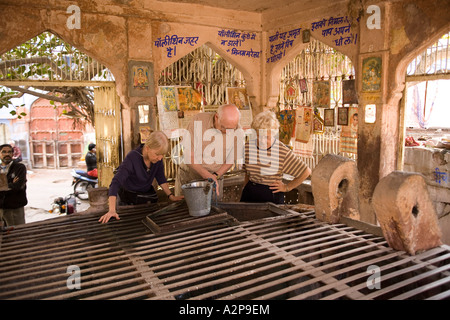 India Rajasthan Jodhpur old city older western visitors in covered well - Stock Photo