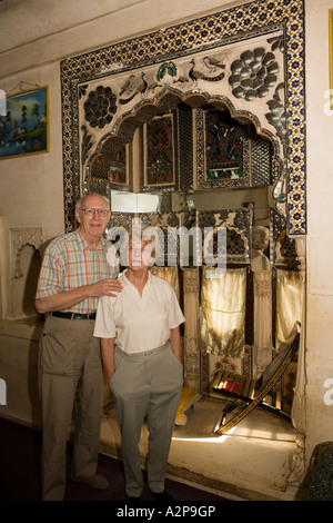 India Rajasthan Jodhpur old city Singhvis Haveli older western couple in traditional shisha room - Stock Photo