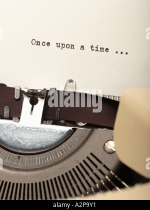 Detail of typewriter and piece of paper with writing Once Upon A Time - Stock Photo