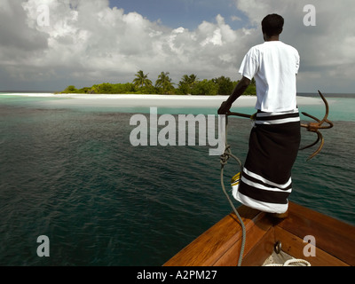 About to drop anchor at a remote desert island in Ari Atoll in the Maldives - Stock Photo