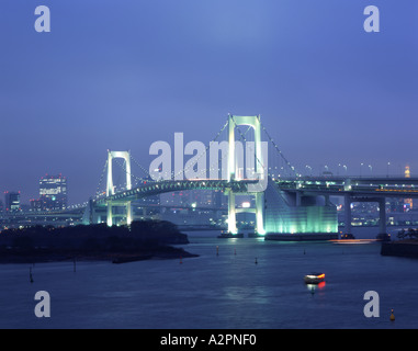 The Rainbow Bridge that connects central Tokyo to Daiba over Tokyo harbor - Stock Photo