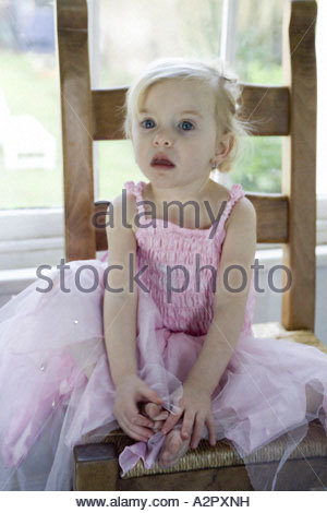 Young girl dressed in pink fairy outfit Model release - Stock Photo