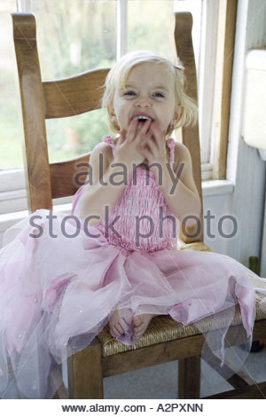 Young girl dressed in pink fairy outfit laughing Model released - Stock Photo