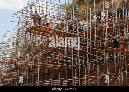 Workers doing reconstruction and restoration work on Abhayagiri Dagoba in Anuradhapura, Sri Lanka - Stock Photo