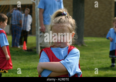 Little girl frustrated at soccer/football practice - Stock Photo
