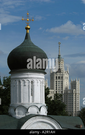 Russian orthodox church in Zaryadye and a skyscraper from the Stalin's era in the background in Moscow, Russia - Stock Photo