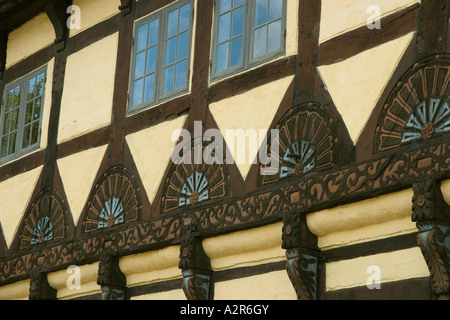 Half timbered house with carvings Odense Denmark - Stock Photo