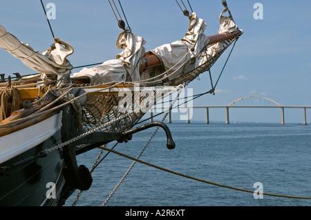 Old tall ship bow with Langelandsbroen in background Rudkøbing Rudkoebing Langeland Denmark - Stock Photo