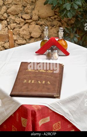 Menu opened on restaurant table - Stock Photo