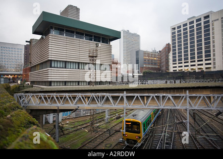 The Grade 2 listed corrugated concrete signal box overlooking rails leading into New Street station in Birmingham - Stock Photo