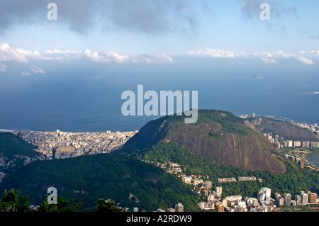 View towards Copacabana over Morro dos Cabritos Hill from Corcovado Hill Rio de Janeiro Brazil - Stock Photo