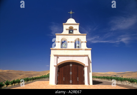 USA California Paso Robles Spanish Mission style church on hill with grape vineyard - Stock Photo