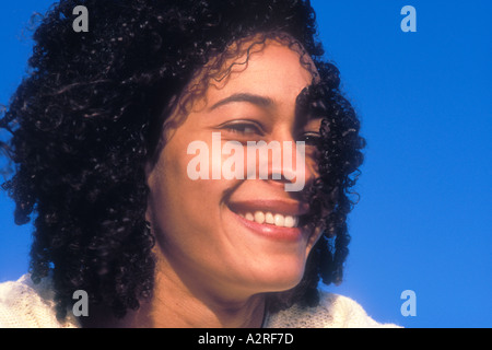 Portrait of smiling mixed Caucasian African American female - Stock Photo