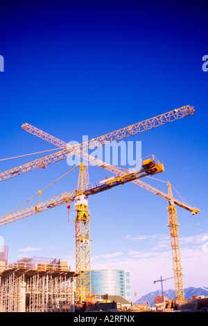Building Cranes on a Highrise Construction Site in the City of Vancouver British Columbia Canada - Stock Photo