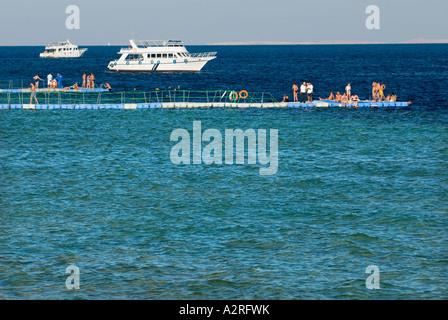 swimming platform base diver  HOUSEREEF house reef riff Sharm El Sheikh EGYPT Om El Sid Plateau people tourists - Stock Photo