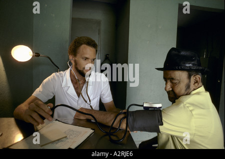 Man having his blood pressure taken in a health clinic in Havana, Cuba - Stock Photo