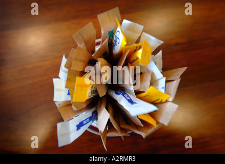 A BOWL OF SUGAR IN SACHETS IN THE CLUB LOUNGE OF THE PRIDE OF CANTERBURY P O FERRY AT DOVER DOCKS KENT ENGLAND UK - Stock Photo