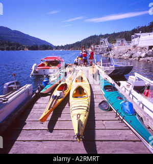Kayaks on a Dock at Fulford Harbour on Saltspring Island in the Southern Gulf Islands British Columbia Canada - Stock Photo