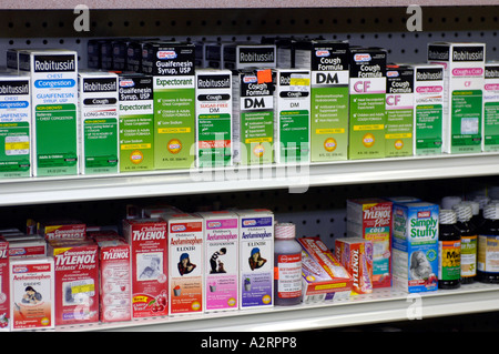 A display of cough medicines on a pharmacy shelf - Stock Photo