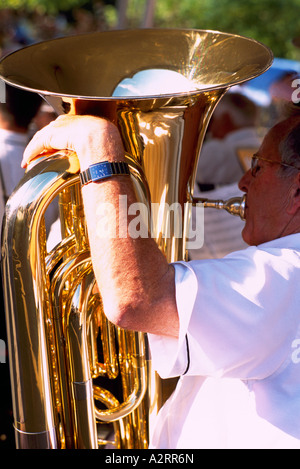 A Senior Man playing a Tuba in a Band - Stock Photo