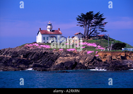The Historic 'Battery Point' Lighthouse (built in 1855) on a Rocky Island at Crescent City California United States - Stock Photo