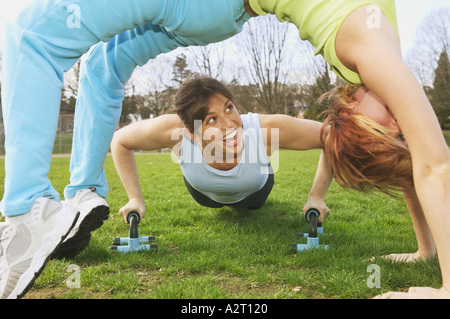 Two young women working out together - Stock Photo