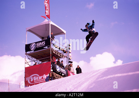 A Snowboarder competing at a Snowboard Competition Whistler British Columbia Canada - Stock Photo