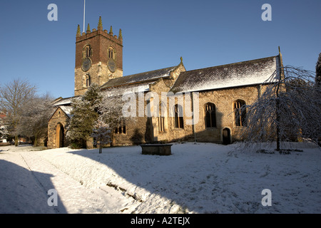 The Parish Church of All Saints Diocese of York Market Weighton East Yorkshire UK carpeted in snow - Stock Photo