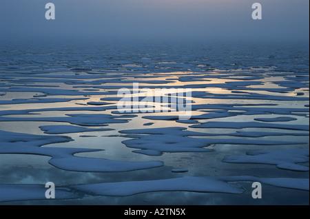 Sea ice breaking up near Pond Inlet, Baffin Island, Nunavut, Canada. - Stock Photo