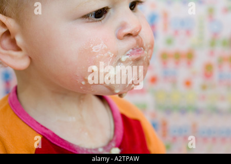 Child covered in food - Stock Photo