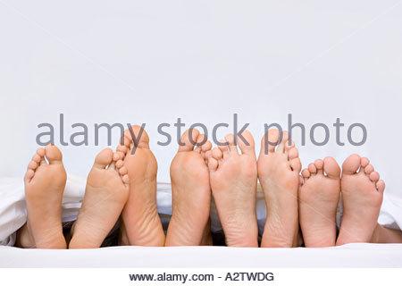 A row of bare feet - Stock Photo